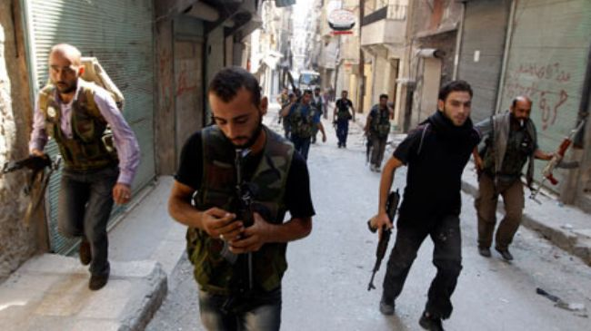 File photo shows militants with the so-called Free Syrian Army in the northern Syrian city of Aleppo.