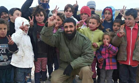 Abdul Waheed Majeed with Syrian children in a photo said to have been taken at a refugee camp on the border with Turkey. Photograph: PA