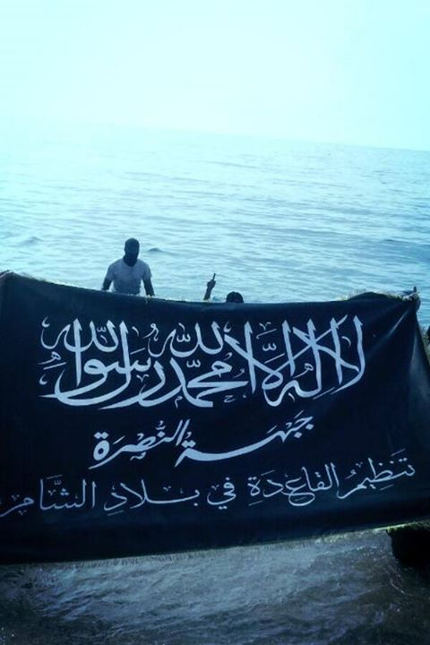 "Dr. Joshua Landis, internationally recognized Syria expert and founder of Syria Comment, linked to this photo on his Twitter account today (3/29). Landis commented: ""Al-Qaida's flag now flies on the Mediterranean Sea"" -presumably in acknowledgement of the historic precedent this sets."