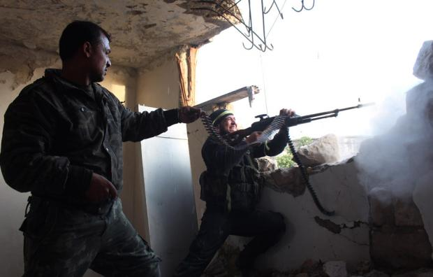 Rebel fighters fire a machine gun during clashes with pro-government forces on March 18, 2014 in the northern Syrian city of Aleppo. (Photo: AFP- AMC/Tamer al-Halabi)
