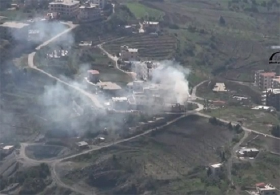 Smoke rises from the town center in Kessab after days of attacks by extremist militants crossing over from Turkey