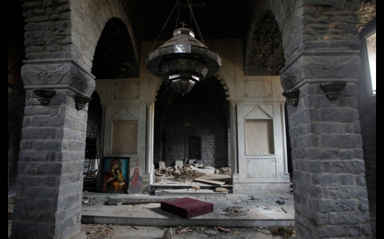 Paintings of Mary and Christ are seen in the damaged Um al-Zenar church in Homs, Syria, May 9. (CNS/Reuters/Khaled al-Hariri)