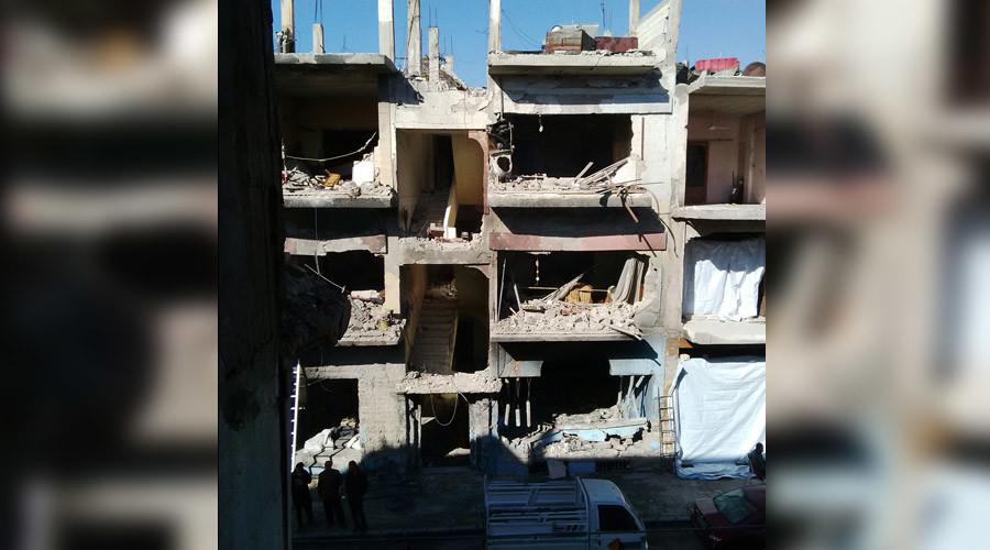 Homes opposite the terrorist car bombing blast in al-Zahra'a, Homs (Dec 2015), Russia Today       © Eva Bartlett